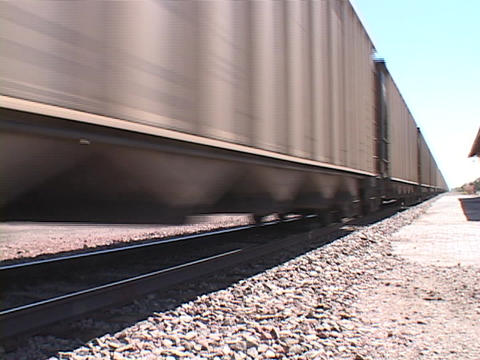 The Cars Of A Freight Train Pass Along The Iron Tracks stock footage