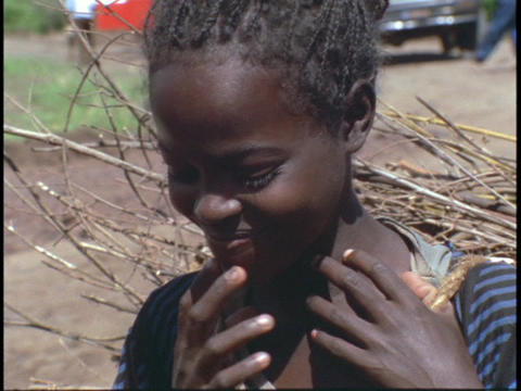 An Ethiopian girl smiles shyly Footage