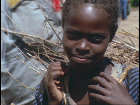 An Ethiopian girl smiles shyly Stock Video Footage
