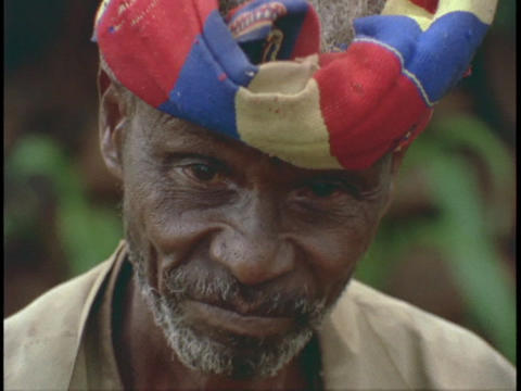 A smile African man put on his turban Stock Video Footage