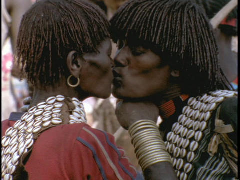 An African man and woman kiss Stock Video Footage