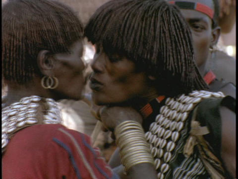 An African man and woman kiss Footage