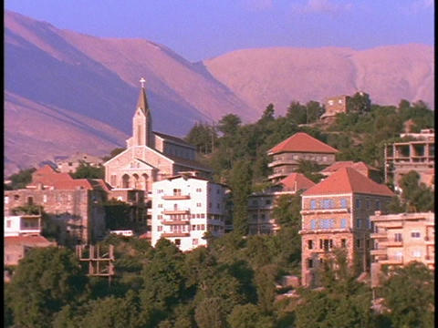 A village lies beneath mountains Live Action