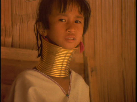 A girl of the Susan Tribe wears neck rings Stock Video Footage