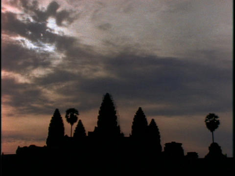 Sunlight tries to break through the clouds over Angkor... Stock Video Footage