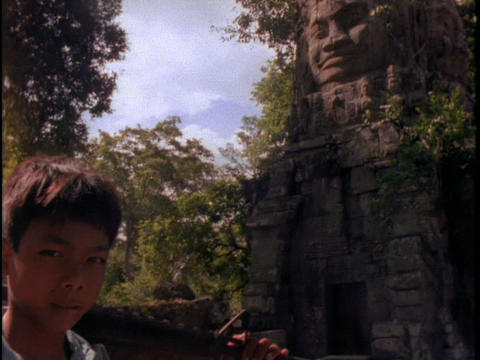 A Khmer Rouge boy holds a gun Footage