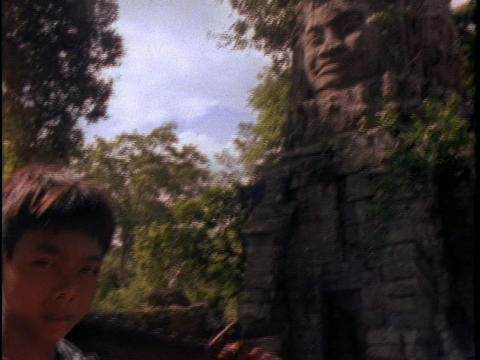 A Khmer Rouge boy holds a gun Stock Video Footage