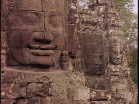Stone faces peer out of Angkor Wat Stock Video Footage