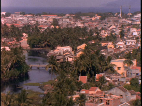 A fishing village lies near a river Footage