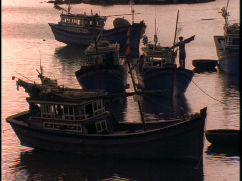Fishing boats float on water Footage