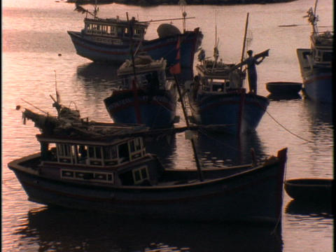 Fishing boats float on water Stock Video Footage