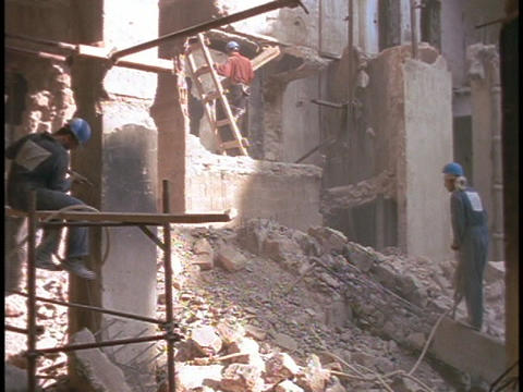 Construction workers work among debris Stock Video Footage