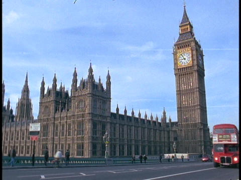 A double-decker London bus passes in front of Parliament and Big Ben Footage