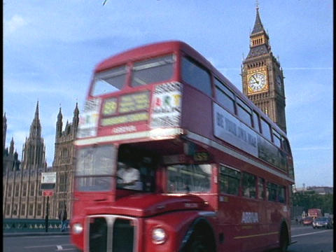 A double-decker London bus passes in front of Parliament... Stock Video Footage