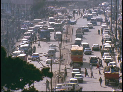 A city in Africa bustles with traffic on a city street Stock Video Footage