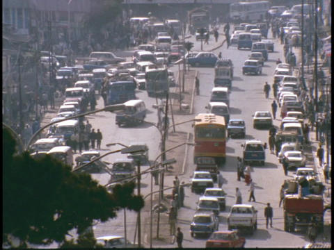 A city in Africa bustles with traffic on a city street Footage