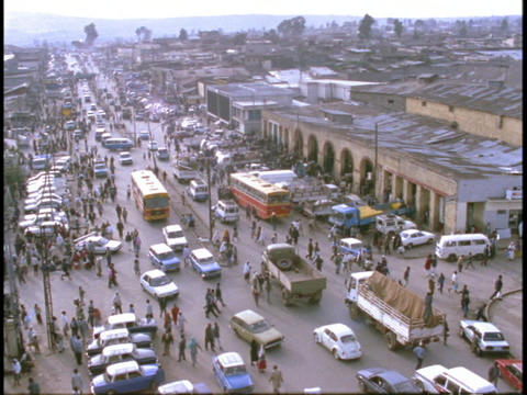 Pedestrians and vehicles crowd a street in Somalia Stock Video Footage