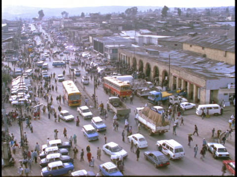 Pedestrians and vehicles crowd a street in Somalia Footage