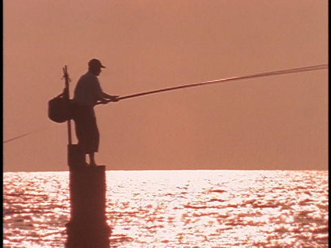 A fisherman fishes with a long pole Stock Video Footage