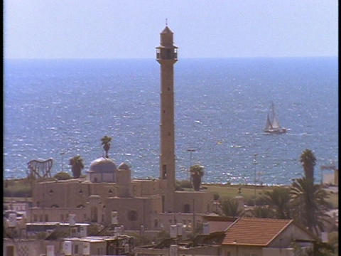 A tall steeple towers over a mosque in Tel Aviv, Israel Footage