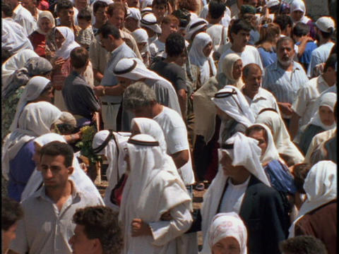 A large Palestinian crowd outside Damascus Gate gathers in the shopping district of Old City Jerusal Footage