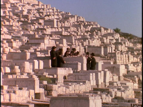Orthodox Jews stand in a cemetery at the Mount of Olives, Jerusalem Footage