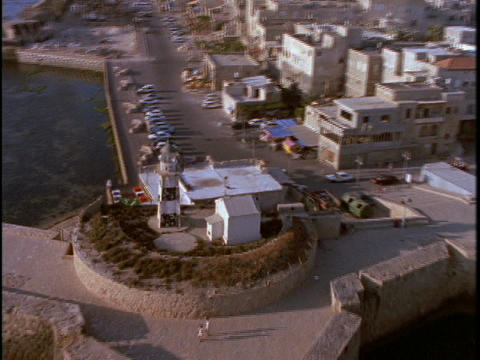 A lighthouse stands on the edge of a Muslim town in Israel Footage