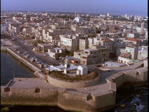 A lighthouse stands on the edge of a Muslim town in Israel Stock Video Footage