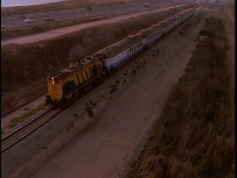 A train speeds across the countryside Stock Video Footage