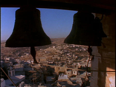 Large bells ring overlooking the Holy land Stock Video Footage