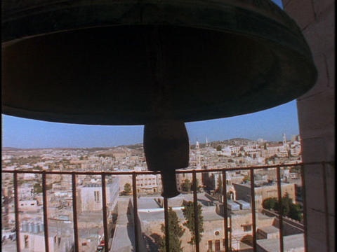 A large bell rings overlooking the Holy land Stock Video Footage