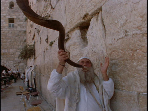 A man blows a shofar at the Western Wailing Wall Footage