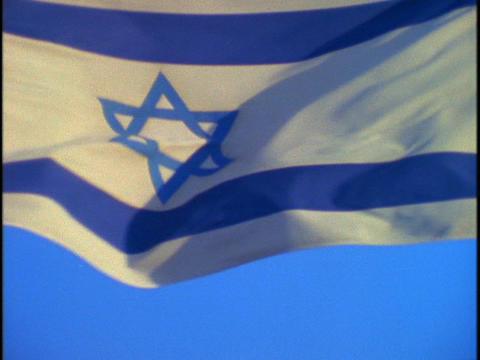 The Israel flag flies in slow motion Footage