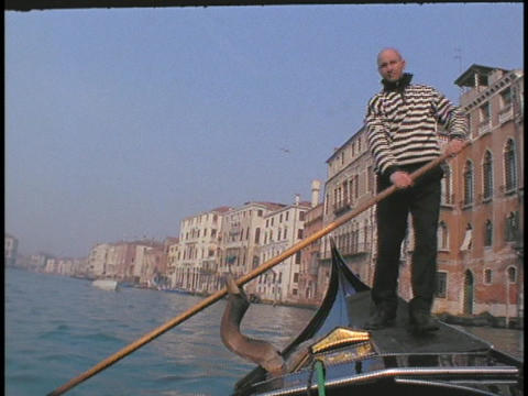 A man rows a gondola in Venice Stock Video Footage