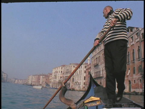A man rows a gondola in Venice Live Action