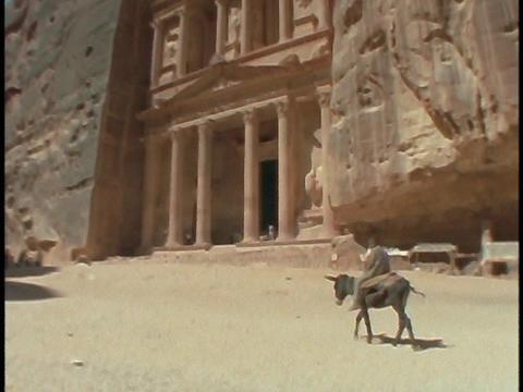 A boy rides a donkey in Petra, Jordan Footage
