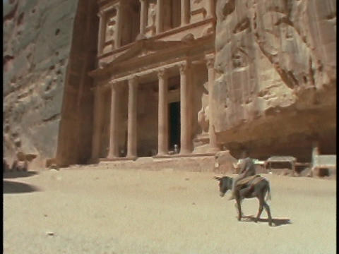 A boy rides a donkey in Petra, Jordan Stock Video Footage
