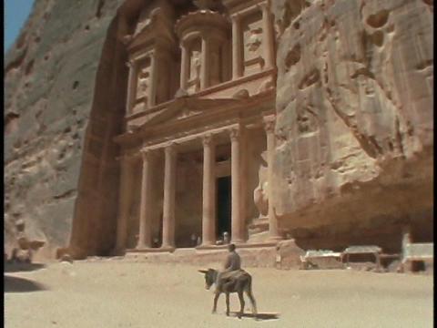 A boy rides a donkey in Petra, Jordan Stock Video Footage
