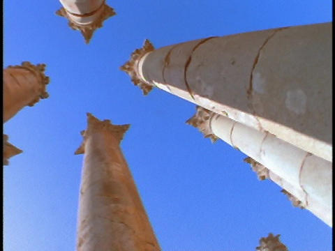 Ancient Roman pillars stand out against a blue sky Stock Video Footage