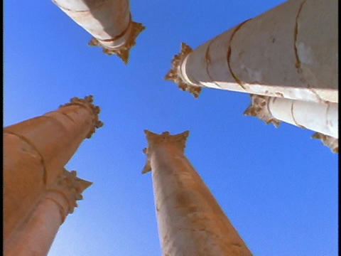 Ancient Roman pillars stand out against a blue sky Footage