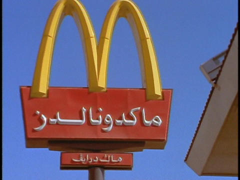 A McDonald's sign has Arabic words on it Stock Video Footage