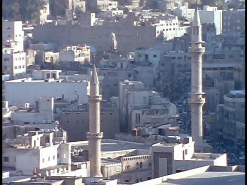 Mosque towers rise above downtown Amman, Jordan Stock Video Footage