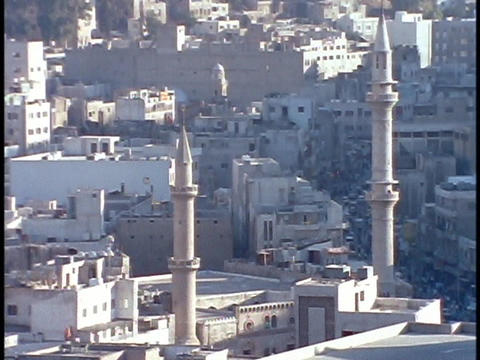 Mosque towers rise above downtown Amman, Jordan Footage