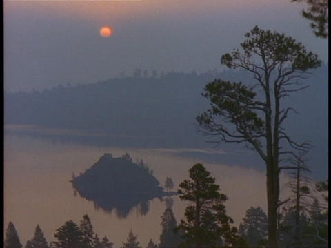 The golden hour sun shines over Lake Tahoe Stock Video Footage