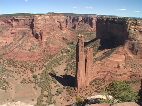 A giant spire juts up in the Canyon de Chelly in New Mexico Stock Video Footage