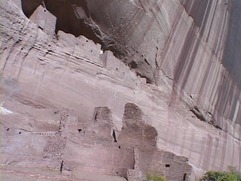 Striations run down a cliff wall at the ruins of Canyon de Chelly in New Mexico Footage
