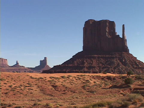 Rocky buttes cover the landscape in Monument Valley, Utah Live Action