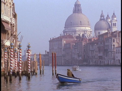 Small power boats cross a canal in Venice Stock Video Footage