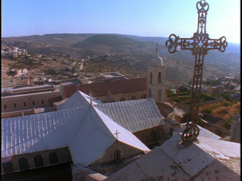 A cross adorns the roof of the Church Of the Nativity in Bethlehem Footage
