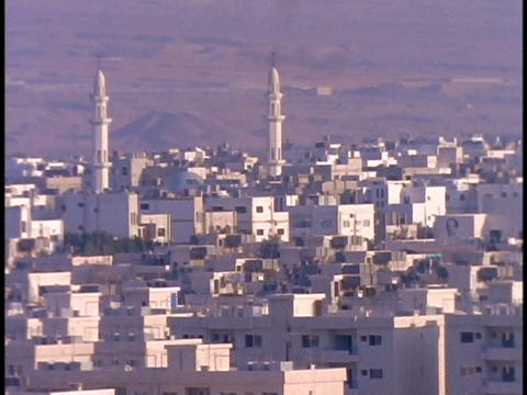 Minarets tower over the white buildings of Aqaba, Jordan Stock Video Footage